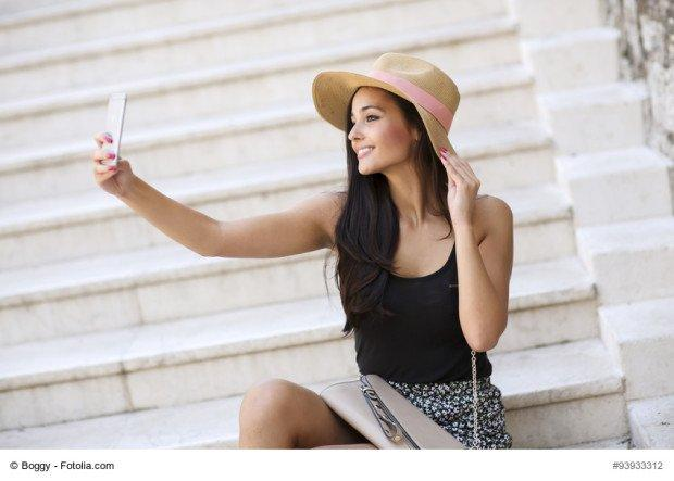 Young woman taking selfie outdoor