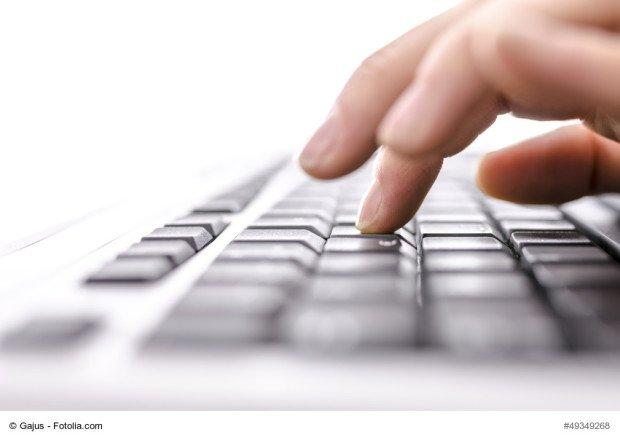 Business woman typing on keyboard. Shallow dof.