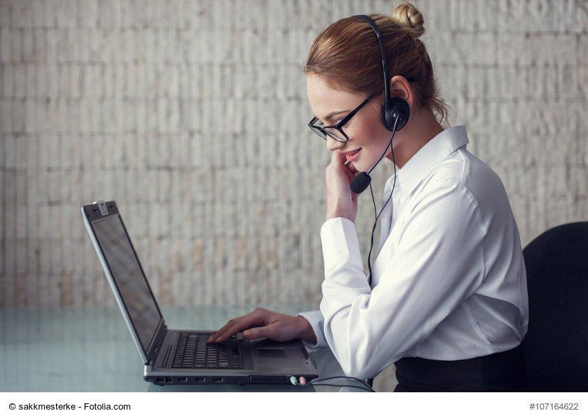 Female customer support emloyee talking online in office
