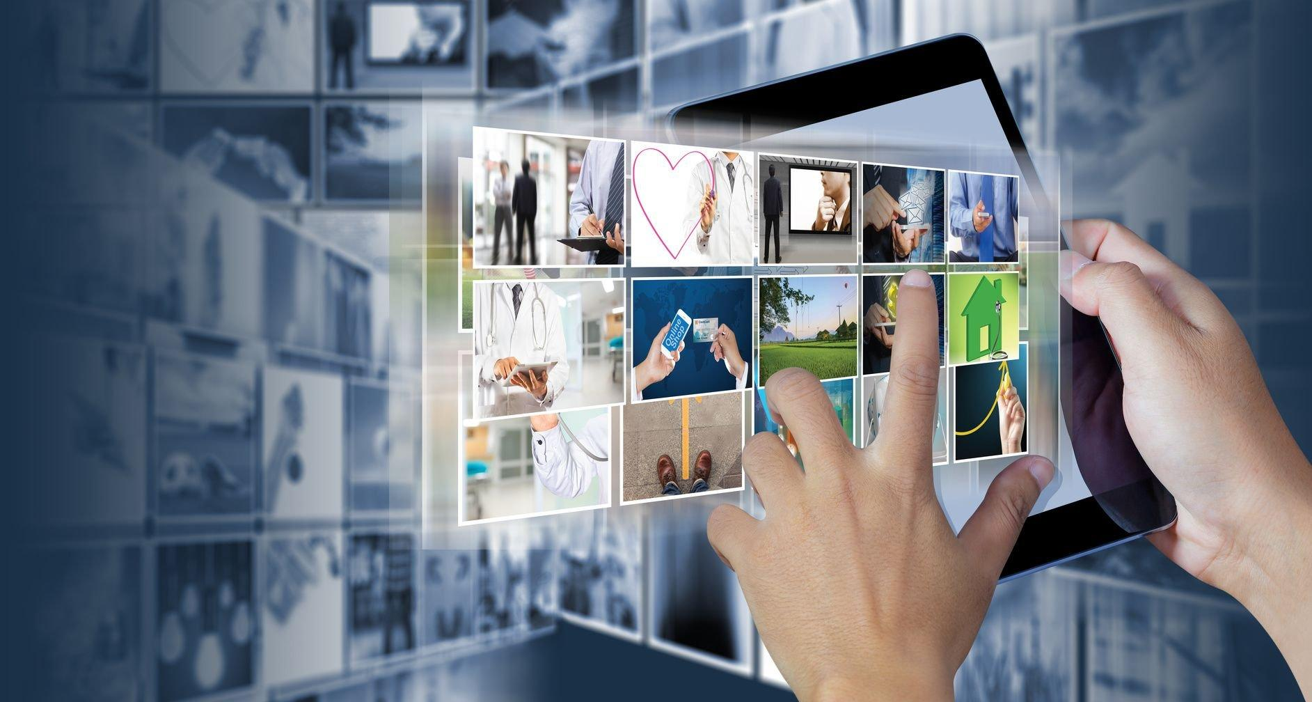 Hand holding the digital tablet with Picture gallery