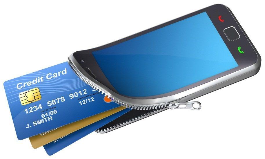 Smatphone con carte di credito incorporate per pagare in modo digitale