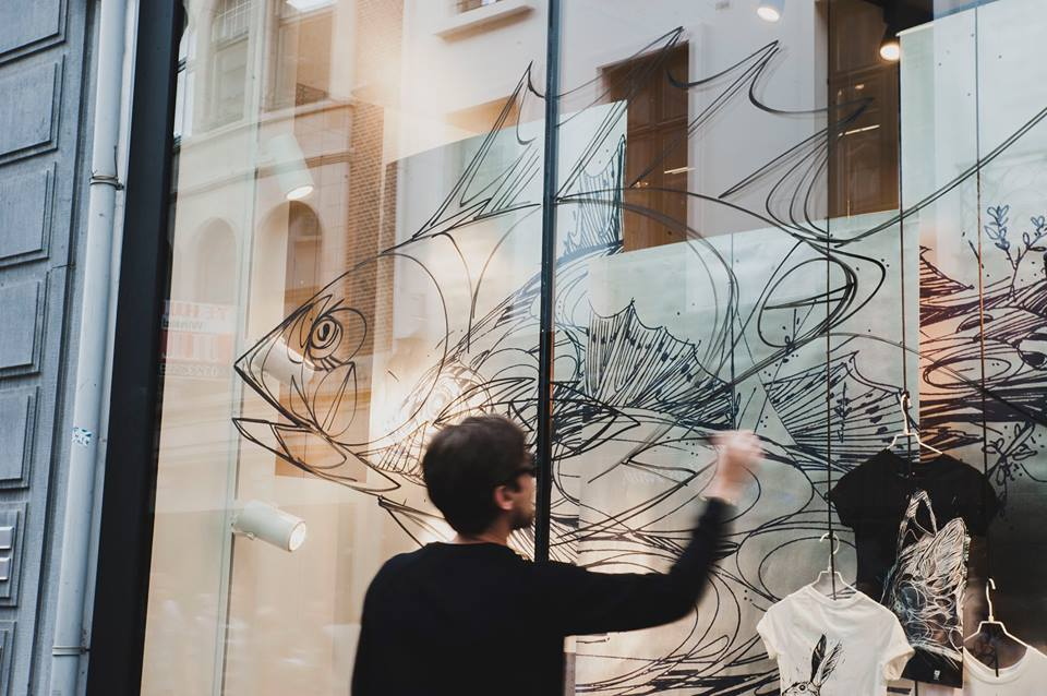 Live painting di Dzia per la presentazione della collezione in uno store CKS ad Anversa
