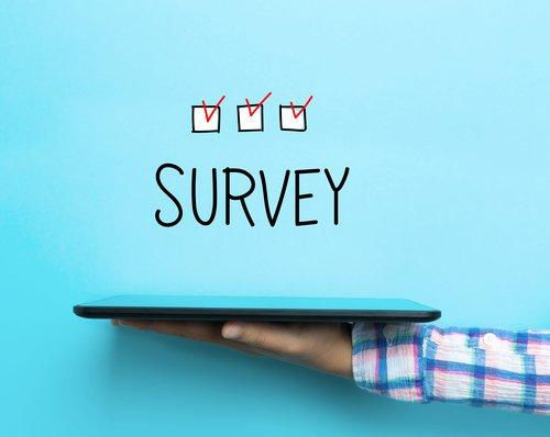 Survey concept with a tablet on blue background